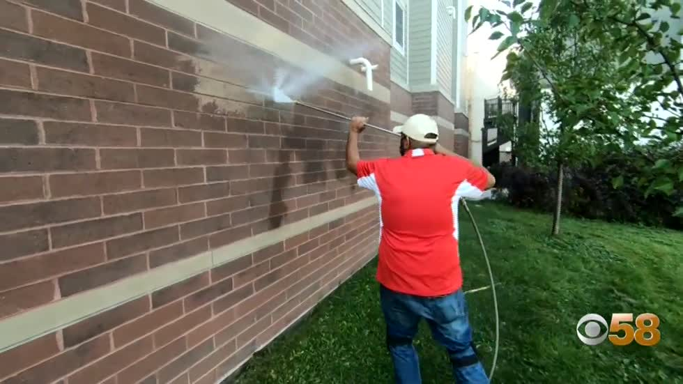 Power washing pro works to keep Brady Street neighborhood free...